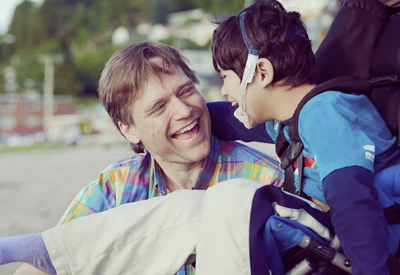 Man and child laughing together