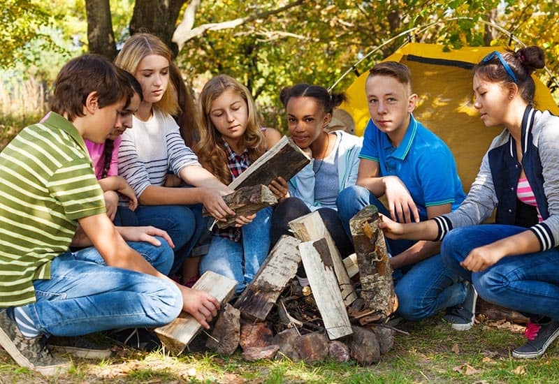 A group of young people camping